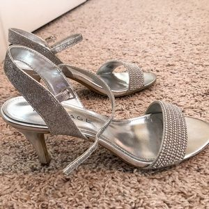 Sparkly silver with rhinestone band heels